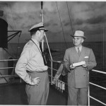 President Truman with Rear Admiral Robert Dennison, Naval Aide to the President, aboard the U.S.S. WILLIAMSBURG