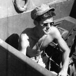 Lieutenant John F. Kennedy sitting in the cockpit of World War II Motor Torpedo Boat PT-109. Credit: Papers of John F. Kennedy. Presidential Papers. President's Office Files. Personal Secretary's Files. PT-109, History. Photograph, PT-109