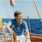 """President Kennedy at the Wheel of the Coast Guard Yacht """"Manitou"""" by Robert L. Knudsen, 1962 (NARA). Current location: National Archives."""