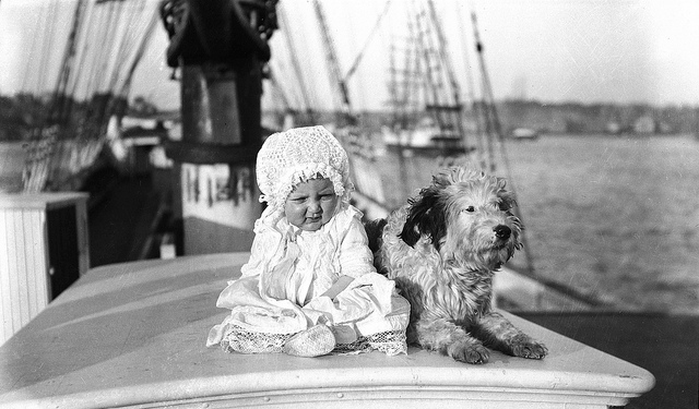 Baby and A Dog on a Sailing Ship By Sam Hood