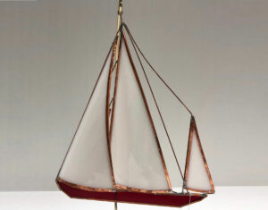 delicate glass ship is a replica of the DORADE