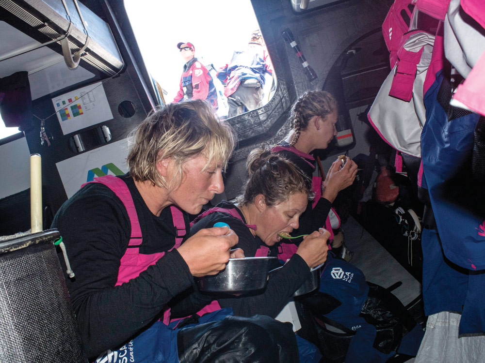 Team SCA eating a meal together