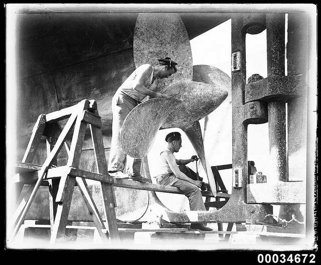 Two Sailors Cleaning A Propeller Of The French Warship BELLATRIX, 1930 1932