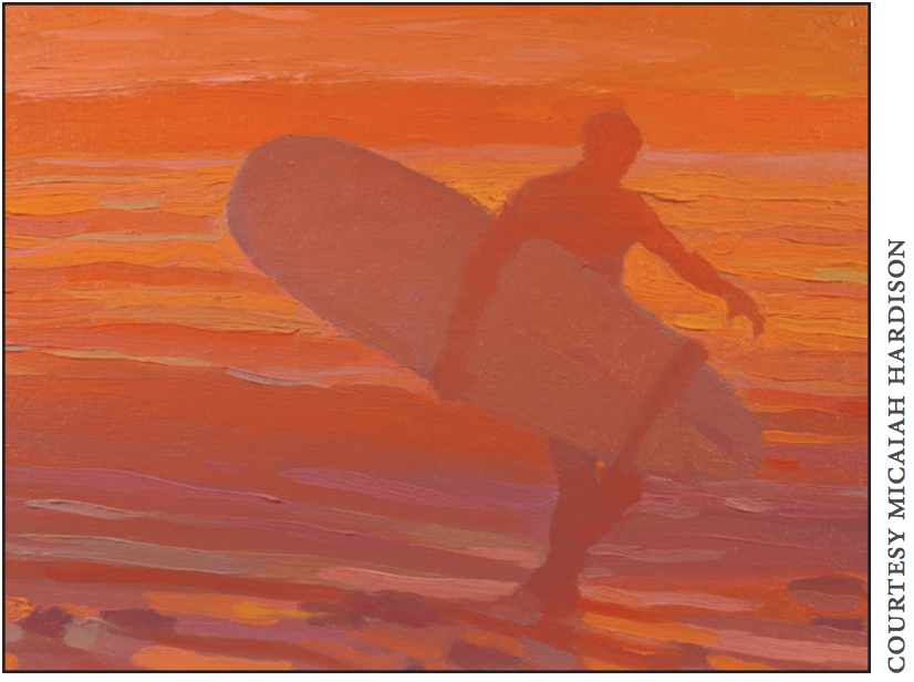 bright sunset in the background of the surfer